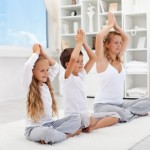 Balanced life - woman with kids doing yoga