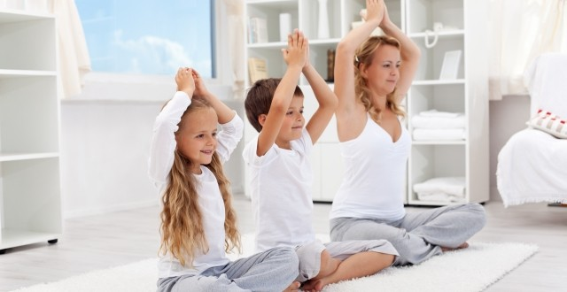 Balanced life – woman with kids doing yoga